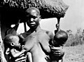 A woman suckling twins, Lango people. Wellcome M0013583.jpg
