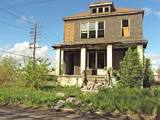 Municipal disinvestment - Shrink to survive is used in cities with a large number of abandoned buildings, such as this home in Detroit.
