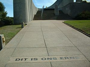 English: Slogan in front of the Afrikaans Lang...
