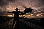 Airman gives take off signal to HSC-14 MH-60S Sea Hawk on USS John C. Stennis (CVN-74) 160211-N-BR087-073.jpg
