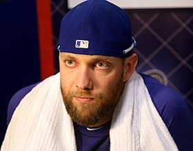 Alex Gordon listens to reporters on -WSMediaDay (22888475465).jpg