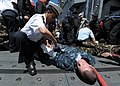 Algerian navy Petty Officer Kamel Yesli, left, applies a bandage to the arm of U.S. Navy Boatswain's Mate 3rd Class James Bare in a mass casualty drill aboard the guided missile frigate USS Simpson (FFG 56) 120518-N-QD416-149.jpg