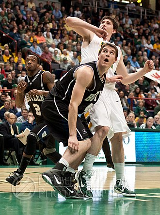 Ryan Rossiter - Butler's Andrew Smith and Siena's Ryan Rossiter both try to anticipate the rebound, as Butler's Shawn Vanzant closes in from behind. Photo taken November 23, 2010.