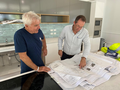 Andrew Wallace MP pointing to plans of the kitchen at endED Butterfly House, now Wandi Nerida during its construction.png