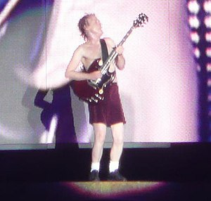 "Angus Young - Young plays a solo during a performance of ""Let There Be Rock"""