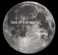 image of the moon showing landing site of apollo 11 around center of the moon
