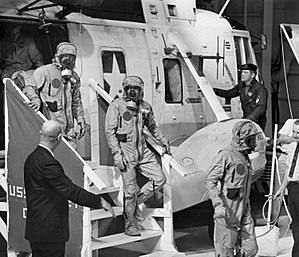 William Carpentier - William Carpentier (pictured inside helicopter) follows Armstrong, Collins, and Aldrin as they arrive on the flight deck of USS Hornet following recovery from the Apollo 11 command module.