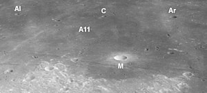 Collins (crater) - Annotated oblique view from Apollo 16 showing the vicinity of the Apollo 11 landing site (A11) with the craters Aldrin (Al), Collins (C), Armstrong (Ar), and Moltke (M), facing north.