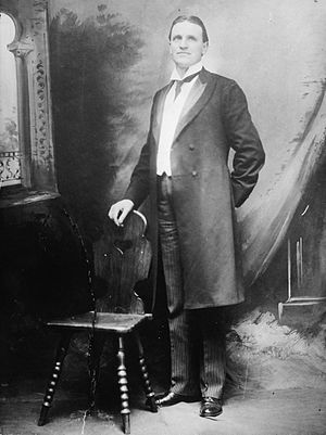 Henry F. Ashurst - Ashurst in his typical frock coat, striped pants, and winged collar.
