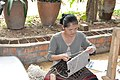 Assembling ladies' bags from hand made paper (14605010282).jpg