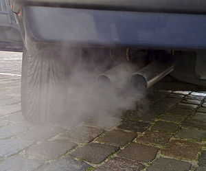 Automobile exhaust gas. White exhaust gas is m...