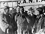 Aviatrix Jean Batten being interviewed after her flight from England to Australia, 1934. (3193274724).jpg