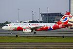 B-6576 - Chongqing Airlines - Airbus A320-232 - Happy Chongqing Livery - CAN (14849687211).jpg