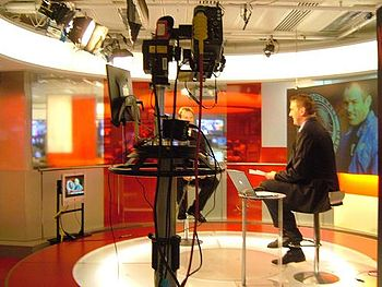 Sir Matthew Pinsent interviewing during a spor...