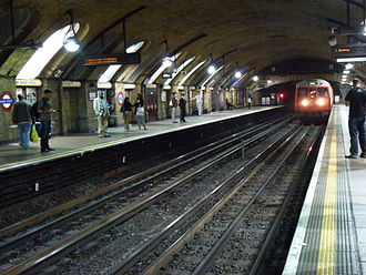 Baker Street tube station - A Hammersmith and City Line train to Barking arrives at Baker Street's oldest platforms built in 1863