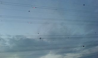 Balisor - Photograph showing Balisor beacons in use on high voltage cables