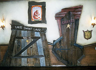 Country Bear Jamboree - The queue for the Disneyland version included fake doors in appropriate shapes for each of the bear performers.