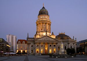 Neue Kirche, Berlin - The New Church seen at twilight, with the marble monument of Friedrich Schiller in the foreground.