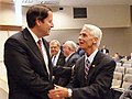 Bill Galvano is greeted by Charlie Crist.jpg