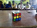 Black speed cube in front of a class zoomed out.jpg