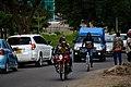 Boda boda motorbike and a cyclist.jpg