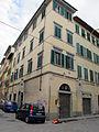 Borgo allegri angolo via ghibellina 42r, casa con stemma sole 01.JPG