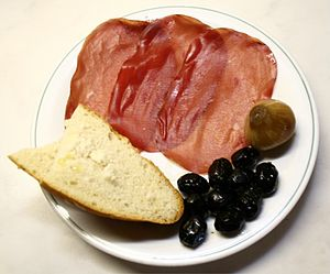 Bresaola - Bresaola della Valtellina (PGI/IGP), olives, a pickled onion and bread