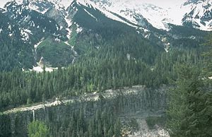 Bridge River Vent - A pyroclastic flow deposit forming the foreground canyon wall on the Lillooet River. The Bridge River Vent is the depression at the upper right corner.