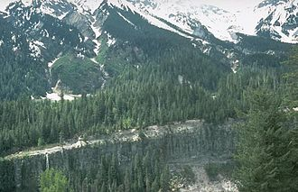 Mount Meager massif - This pyroclastic flow deposit forms the foreground canyon wall on the Lillooet River. It was erupted from the Bridge River Vent on the northeastern flank of Plinth Peak.