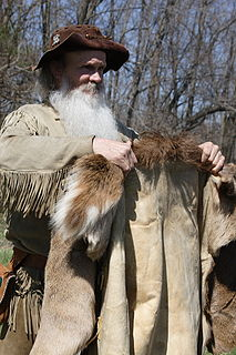 clothing, usually a jacket or tunic and leggings, made of buckskin