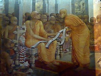 Theravada - Buddhaghosa (c. 5th century), the most important Abhidharma scholar of Theravāda Buddhism, presenting three copies of the Visuddhimagga.