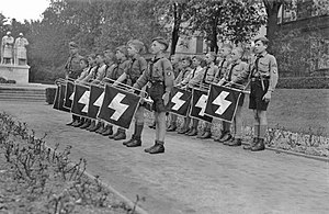 Deutsches Jungvolk - Deutsches Jungvolk fanfare trumpeters at a Nazi rally in the town of Worms in 1933. Their banners illustrate the Deutsches Jungvolk rune insignia.