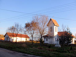 Busenje - center of village with new Catholic church 1993.