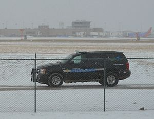 Airport police - A Cleveland Hopkins International Airport Police officer patrols the airport perimeter in a Chevy Tahoe Police Cruiser.