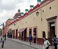 Calle Jalisco, Dolores Hidalgo, Guanajuato - Fachadas, banderas y Templo de la Tercera Orden.jpg