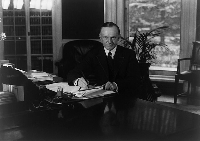 Calvin Coolidge seated at desk in Oval Office LOC3b39484r.jpg