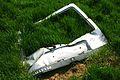 Car Tailgate Fly-Tipped. Old Woking Surrey UK.jpg