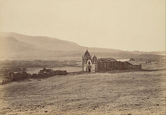 Mission San Carlos Borromeo de Carmelo - The mission in ruins circa 1883. Photo by Carleton Watkins