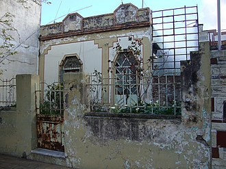 Waiting for the Hearse - Sergio's house on Echenagucía street in 2010, visibly damaged.