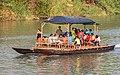 Catamaran pirogue transporting people on the Mekong in Don Det, Laos.jpg