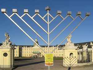 Public menorah - A large Chabad-style menorah in front of the Karlsruhe Palace in Karlsruhe, Germany before a public Chabad-Lubavitch menorah lighting ceremony (2006).