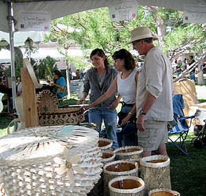 Santa Fe Indian Market - Cherish Parrish (Gun Lake Band Potawatomi) explains her baskets to visitors at her booth