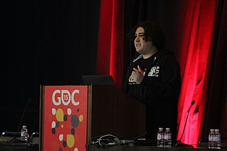 Clash of Clans - Jonas Collaros, one of the coders in the Clash of Clans team, speaks about the game's design at an event.