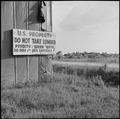 Closing of the Jerome Relocation Center, Denson, Arkansas. Old sign at the Jerome Center's lumber yard. - NARA - 539740.tif