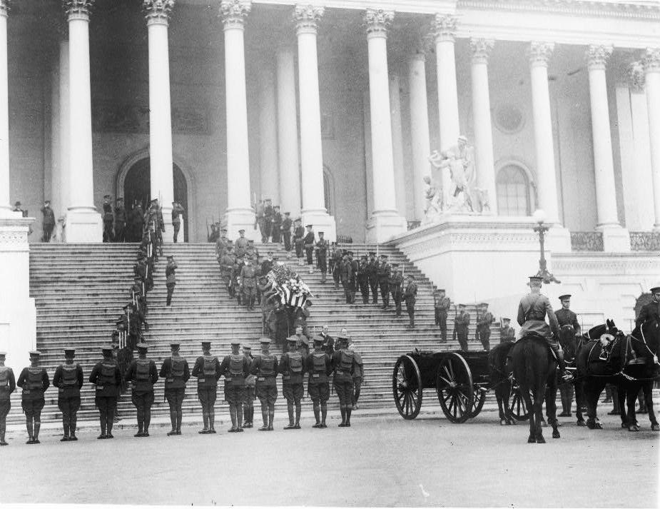 Coffin of the Unknown Soldier being brought down steps