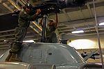 Conducting maintenance on a main rotor 121203-M-TK324-027.jpg