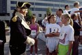 Costumed historical intrepeter talks with runners at the Race for the Cure run in 1990, Pennsylvania Avenue, Washington, D.C LCCN2011632673.tif