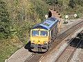 Cowley Bridge - GBRf 66735 spoil train from Crediton.JPG
