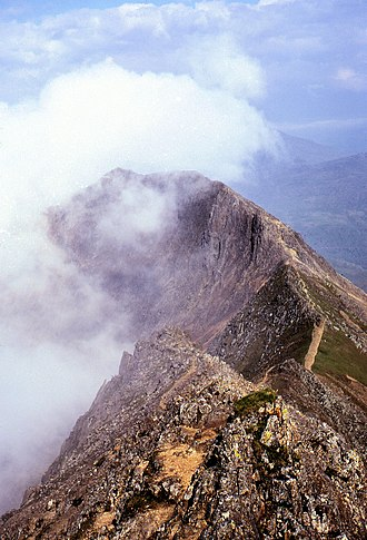 Scrambling - Part of the Crib Goch ridge, Wales. An easy section of the path runs over the grassy saddle.