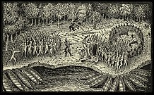 A black and white engraving.  Two masses of Native North Americans face each other in the center, firing at each other with bow and arrow.  In front of each group there are a number of canoes pulled up against the shore of a body of water.  In the background there are trees.  Between the two groups stands a single man wearing some sort of armor.  He is firing a rifle or musket at the group on the right, and you can see the puff of smoke rising from the weapon.  Further back near the trees are two other men who are also firing weapons at the group on the right.  There are two wounded individuals lying next to the group on the right.